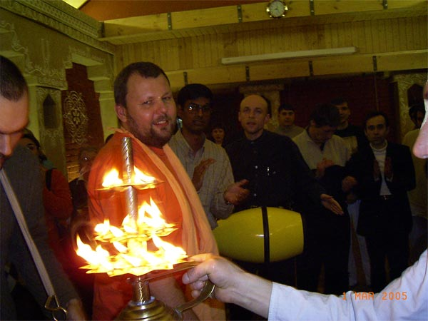 offering a sanctified fire to all the devotees and guests